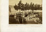 3e zicht op de oude brugsluis en restanten van de oude Tolhuispoort met op de achtergrond de katoenfabriek van M. Parmetier